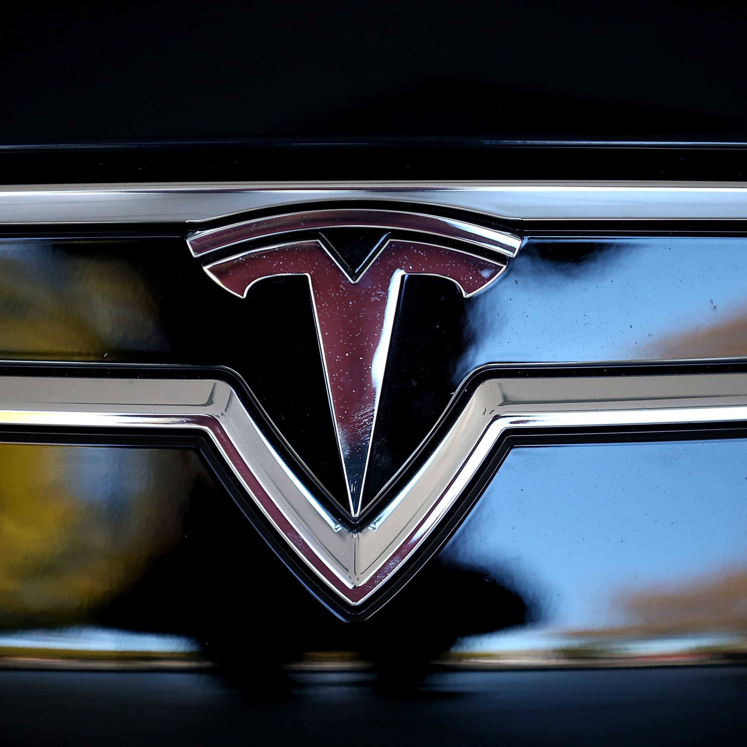 heres what the tesla logo looks like when its not on an illegal
