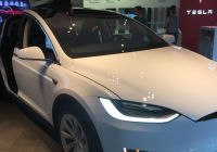 Tesla with butterfly Doors New the Model X Seen at the Tesla Showroom In Vancouver
